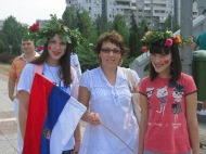 mother & daughters, flag & flowers