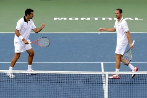 Llodra & Zimonjic en route to winning the 2011 Rogers Cup in Montreal.  Photo: Matthew Stockman/Getty Images